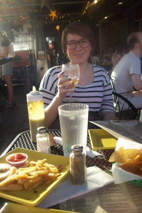 Emma! Yucca fries with garlic oil! Birthday champagne!